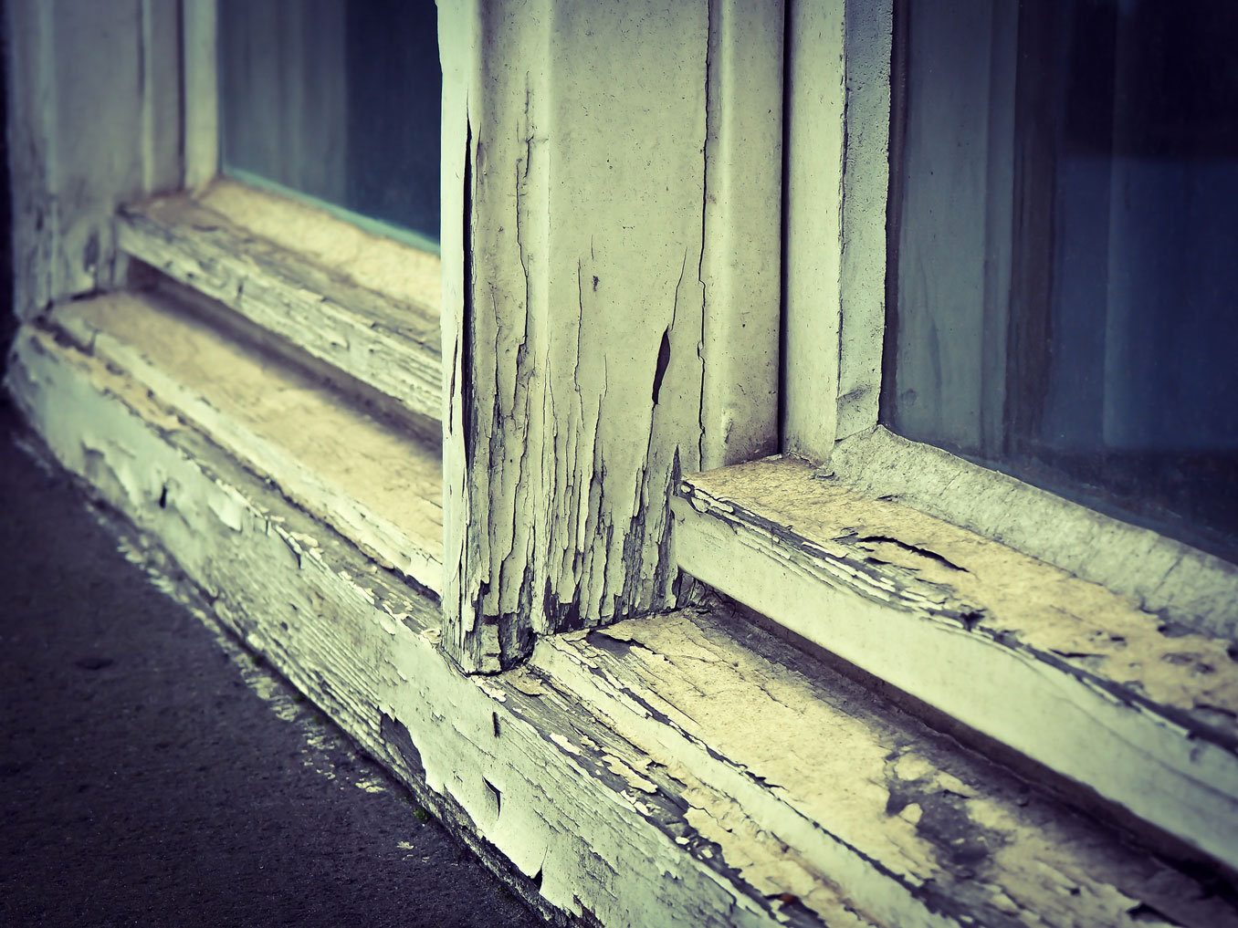 An old window frame with peeling paint