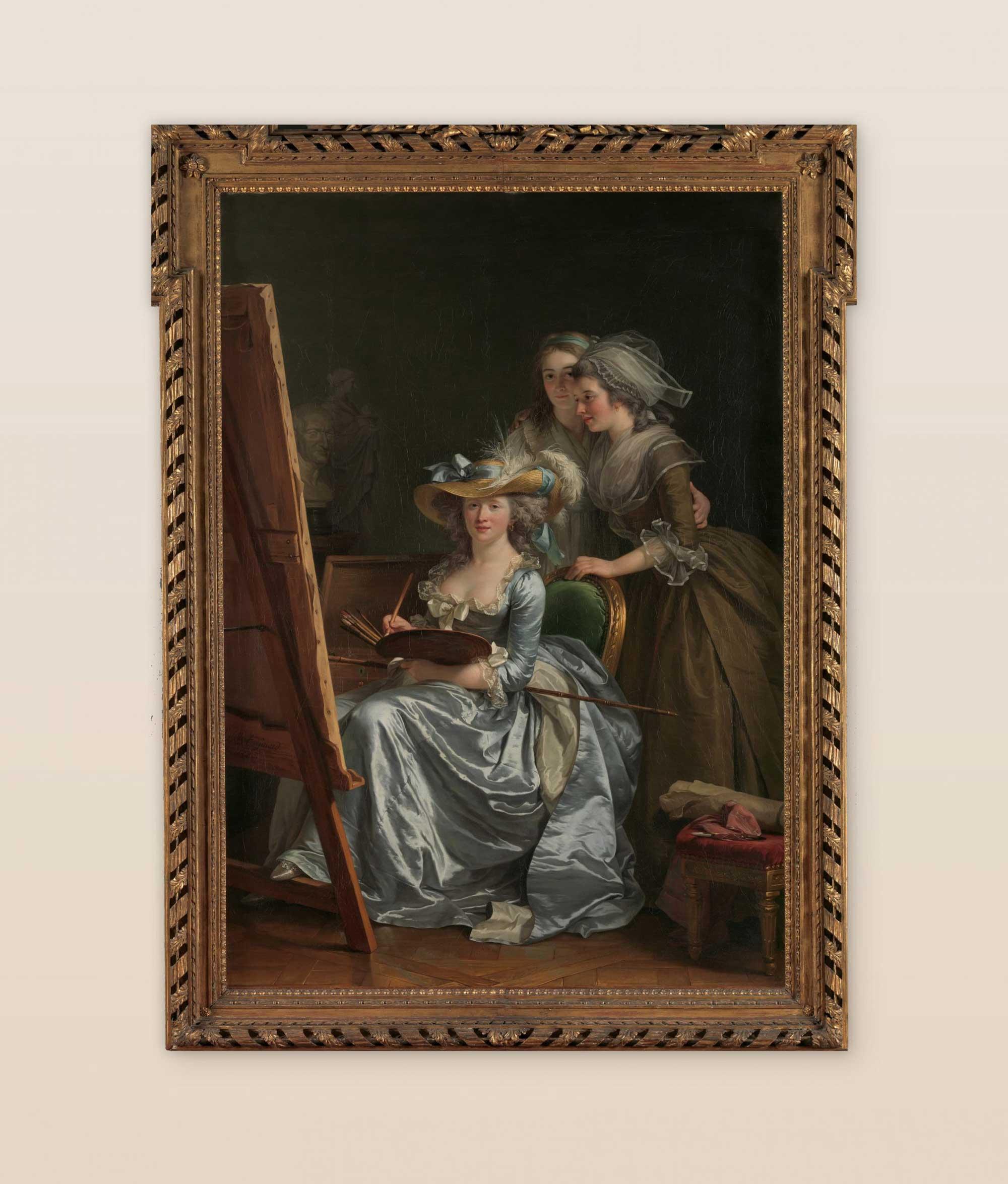 """Self-Portrait with Two Pupils, Marie Gabrielle Capet and Marie Marguerite Carreaux de Rosemond"" by Adélaïde Labille-Guiard, hung up on a gallery wall."