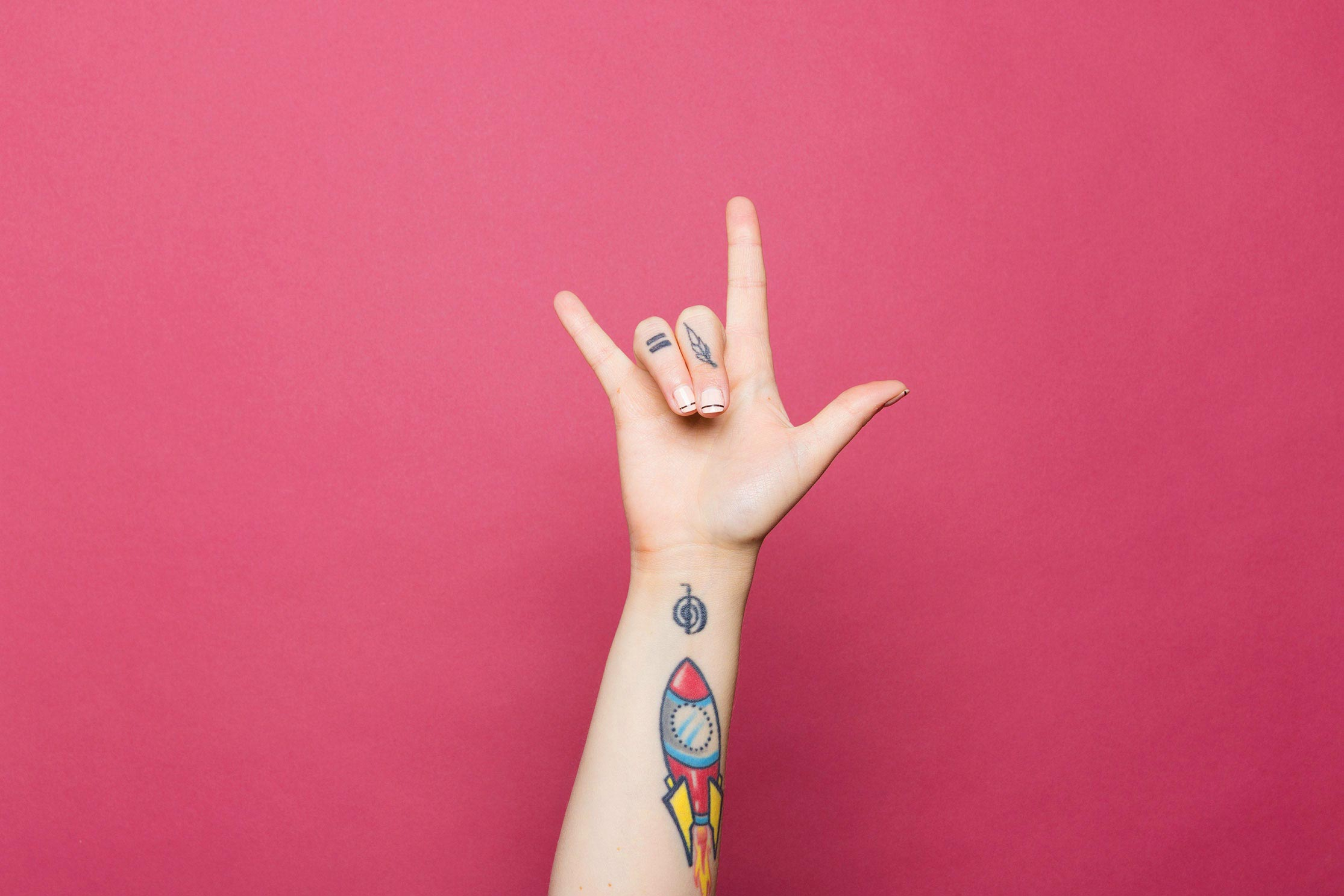 A photo of a tattooed hand, giving the
